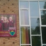 Amesbury CE Primary School building sign close up